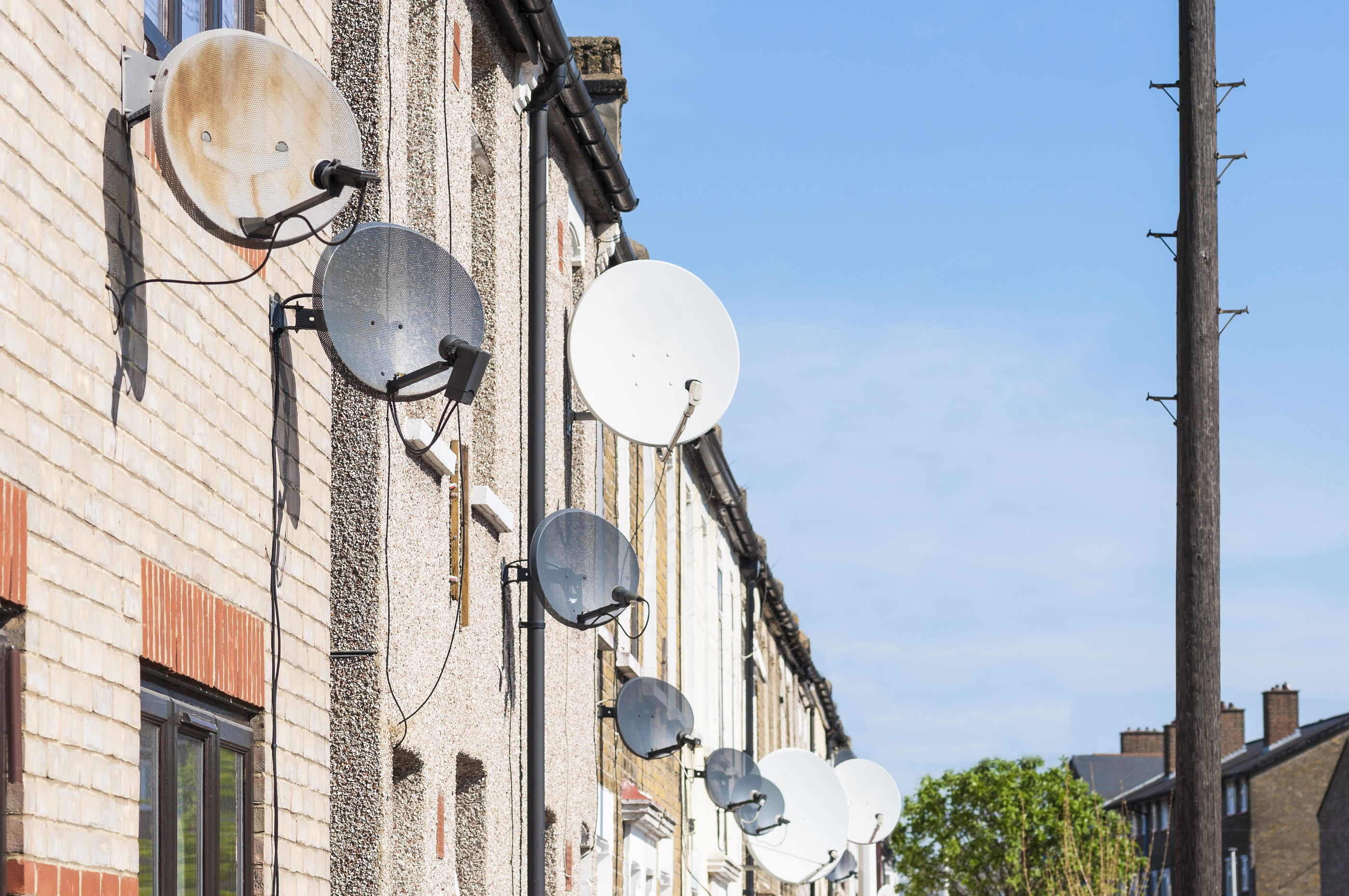 bigstock-Row-of-satellite-dishes-instal-32382467.jpg